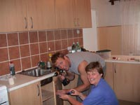 Maire and Glen Install a new kitchen in the school.