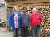 Vascille with Aodh & Maire in front of his wood supply for next Winter.